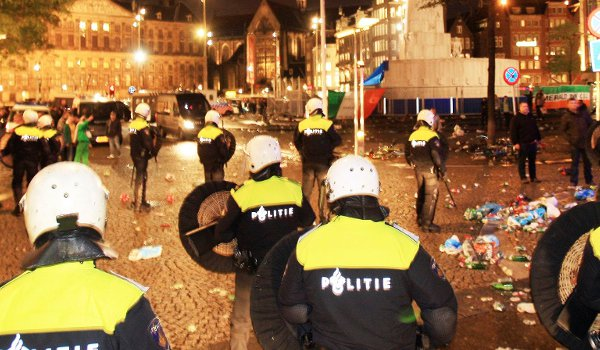 Six Celtic supporters were charged were charged with acts of violence against police officers in a public space