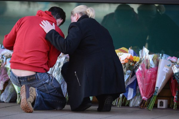 Mourners at the crash site
