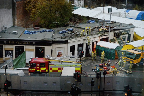 Piolice have said a ninth body has been recovered in the wreckage of Glasgow's Clutha pub that was destroyed when a police helicopter crashed on Friday night.  (Photo by Jeff J Mitchell/Getty Images)