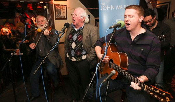 (From l to R): singer John Sheahan, Paddy Reilly and Damien Dempsey paying tribute to singer/songwriter Luke Kelly on the 30th anniversary of his death in January