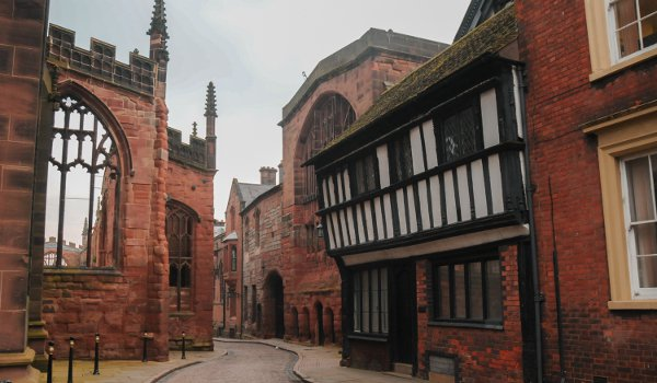 St Mary's Guildhall is centre with its arched entrance facing Coventry Cathedral ruins