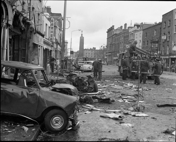 Firemen are pictured assessing the damage at a small garage on Parnell Street. (Irish Photo Archive)