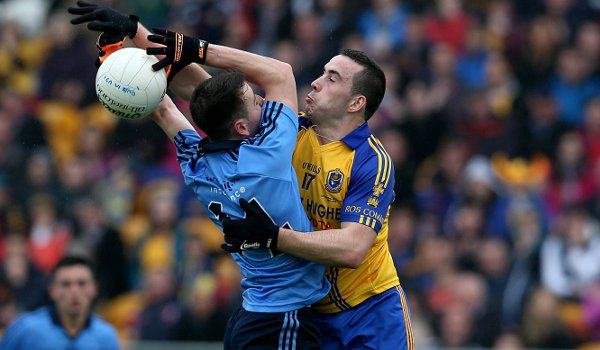 Cormac Costello of Dublin and Thomas Featherston of Roscommon battle for the ball