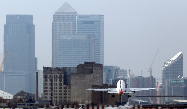 A plane takes off from London City Airport