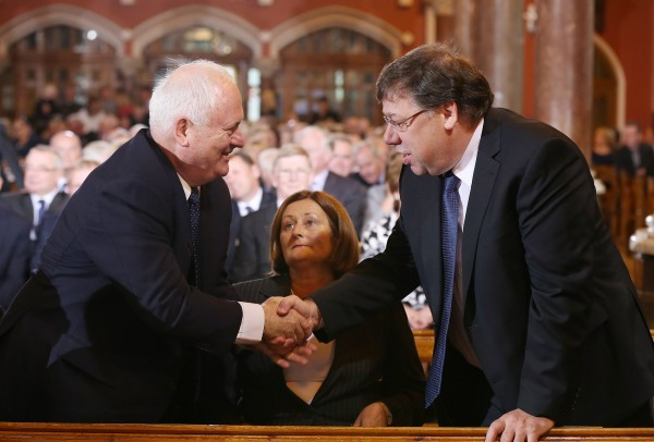 Former Taoiseach Brian Cowen and John Bruton greeting eachj other at the Church of the Sacred Heart in Donnybrook for the removal of of former Taoiseach Albert Reynolds. (Photocall Ireland/GIS)
