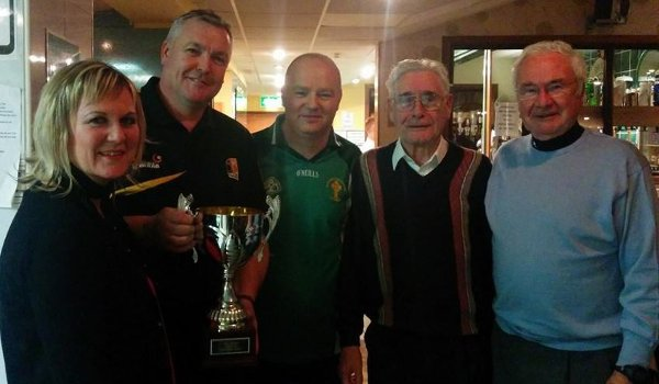 Chairman Tom Nolan presents Coatbridge St Pat's Festival Irish Quiz Winners with their trohpy-n