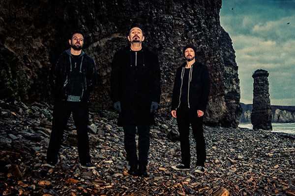 Andy Cairns (Guitar, Vocals); Michael McKeegan (Bass) and  Neil Cooper (Drums)