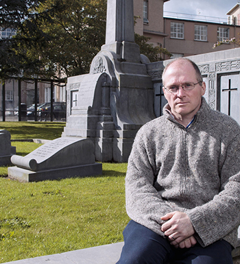 Gabriel Doherty, UCC School of History beside the Republican Grave Plot in UCC (Picture: Tomás Tyner, UCC )