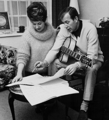 Val and his wife Lynn going over a song in 1965. Picture: Getty Images
