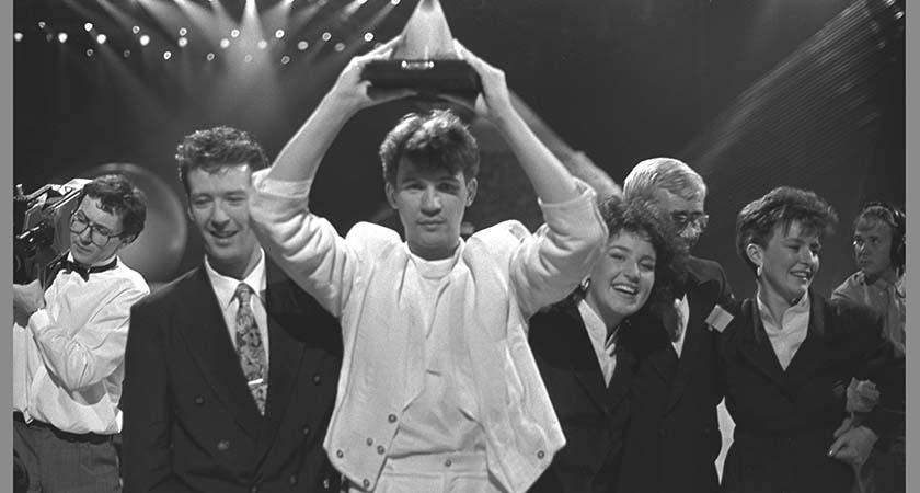 No one rocks a white suit like Johnny Logan wins (Picture: RTE)