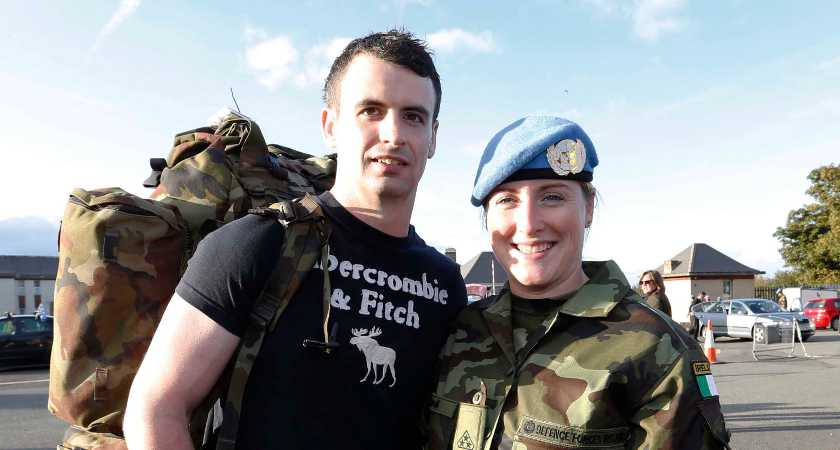 07/10/2015. Irish Troops Return Home. Pictured is Brianna McConnell with her partner Ryan Kely from Donegal as Irish Troops as Return Home to Baldonnell Airport After Completing Six Month Deployment to the Golan Heights. Photo: RollingNews.ie