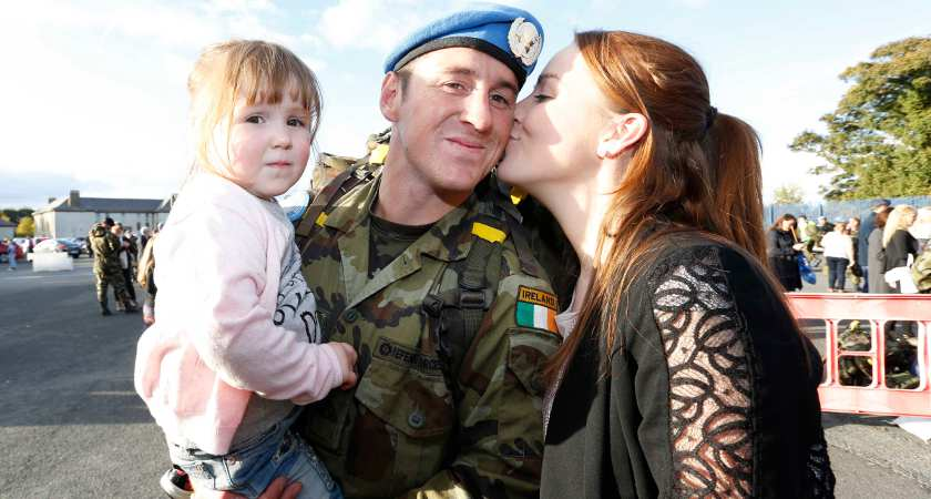 07/10/2015. Irish Troops Return Home. Pictured is John Brown with his daughter Roisin Brown age2 and Partner Sarah from Kildare as Irish Troops as Return Home to Baldonnell Airport After Completing Six Month Deployment to the Golan Heights. Photo: RollingNews.ie