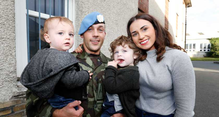 07/10/2015. Irish Troops Return Home. Pictured is Bryan Nolan with his partner Amy Brennan and kids Charlie Nolan age2 and Zack Nolan age1 from Longford as Irish Troops as Return Home to Baldonnell Airport After Completing Six Month Deployment to the Golan Heights. Photo: RollingNews.ie
