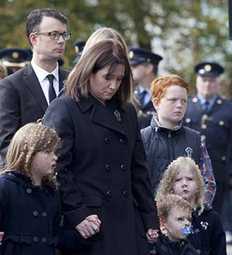 Garda Anthony Golden's Wife Nicola and children Lucy, Alex and Andrew going into the church (Photo: RollingNews.ie)