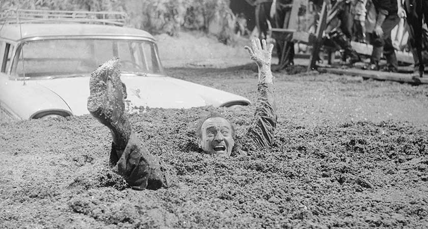 Actor David Niven gets stuck in quicksand in 1962 movie Guns of Darkness Picture: Getty