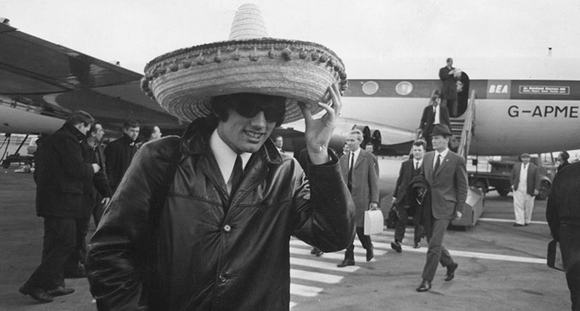 Best stepping off the plane following a famous win over Benfica [Piture: Getty]