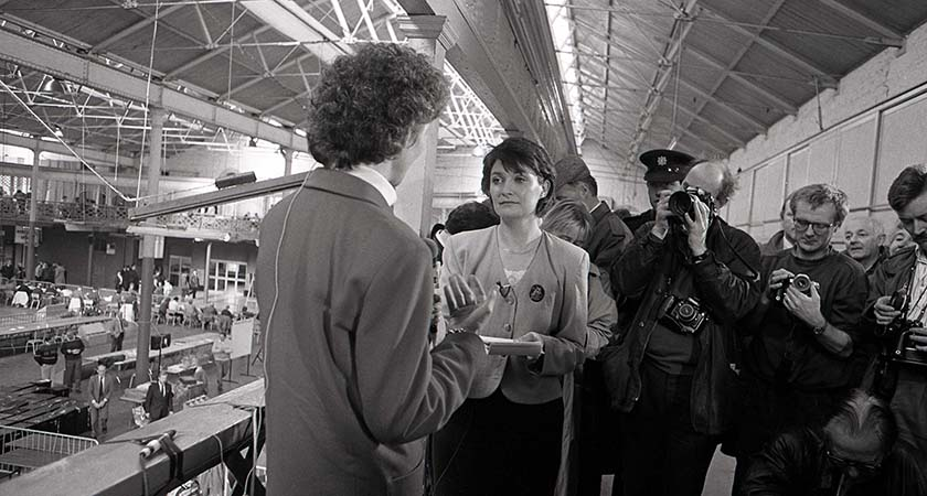 Mary Robinson being interviewed by Una O Hagan of RTE while photographers take pictures at the count centre in the RDS in Dublin at the moment it became clear she had won the presidential election. 9/11/1990 Photo Eamonn Farrell/RollingNews.ie