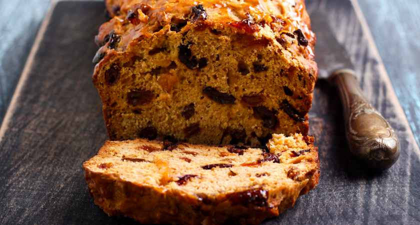 Bara brith traditional Welsh fruit teabread, sliced on board