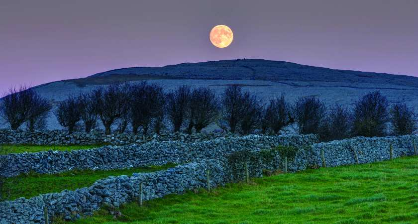 Full moon rising over Abbey Hill. taken from This is the Burren by Carsten Krieger, published by The Collins Press, 2015