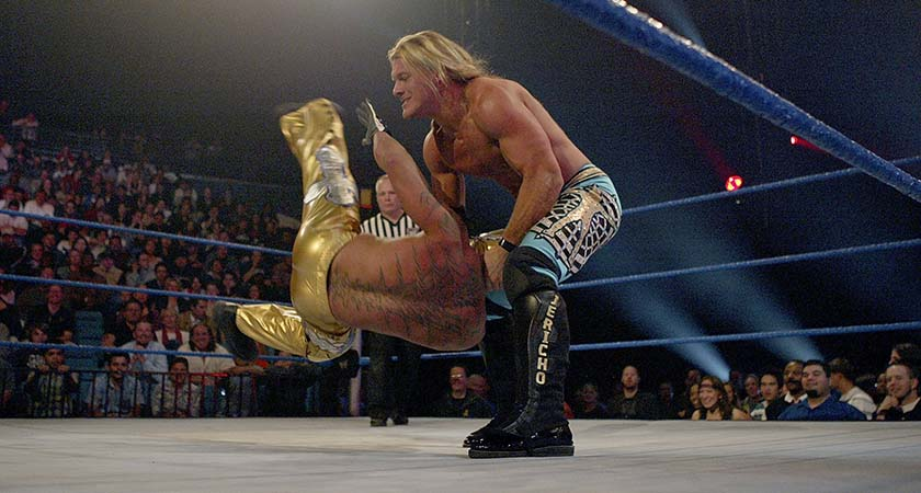"""LAS VEGAS - DECEMBER 2:  (U.S. TABLOIDS OUT)   WWE wrestlers Rey Mysterio (in gold) and Chris Jericho perform on stage during the """"1st Annual Video Game Awards"""" at the MGM Grand Garden Arena December 2, 2003 in Las Vegas, Nevada.  The show premieres on Spike T.V. Thursday, December 4 at 9:00PM ET/PT.  (Photo by Frank Micelotta/Getty Images)"""