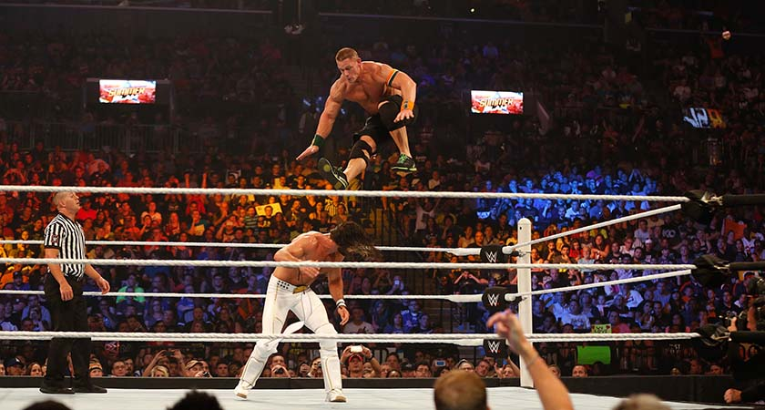 NEW YORK, NY - AUGUST 23:  Seth Rollins and John Cena battle it out at the WWE SummerSlam 2015 at Barclays Center of Brooklyn on August 23, 2015 in New York City.  (Photo by JP Yim/Getty Images)