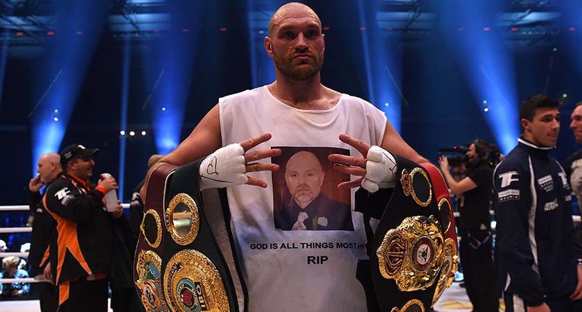 British Tyson Fury celebrates after the WBA, IBF, WBO and IBO title bout against Ukrainian world heavyweight boxing champion Wladimir Klitschko in Duesseldorf, western Germany, on November 28, 2015. Fury won the fight after 12 Rounds of Boxing. AFP PHOTO / PATRIK STOLLARZ / AFP / PATRIK STOLLARZ        (Photo credit should read PATRIK STOLLARZ/AFP/Getty Images)