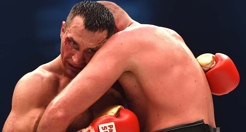 World heavyweight boxing champion Wladimir Klitschko (L) of Ukraine defends against Britain's Tyson Fury during their  WBA, IBF, WBO and IBO title bout in Duesseldorf, western Germany, on November 28, 2015.   Fury dethroned  Klitschko in a 12round decision to become world heavyweight champion. AFP PHOTO / PATRIK STOLLARZ / AFP / PATRIK STOLLARZ        (Photo credit should read PATRIK STOLLARZ/AFP/Getty Images)