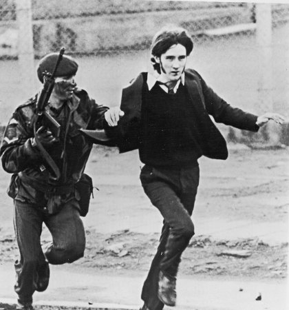 A British soldier with a captured youth on Bloody Sunday. Picture: Getty Images