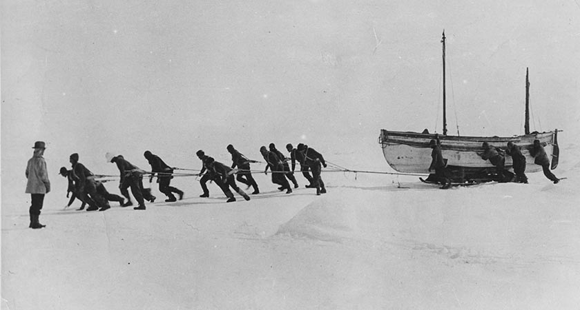 ANTARCTICA - 1916: Members of an expedition team led by Irish explorer Sir Ernest Henry Shackleton pull one of their lifeboats across the snow in the Antarctic, following the loss of the 'Endurance'.   (Photo by Hulton Archive/Getty Images)