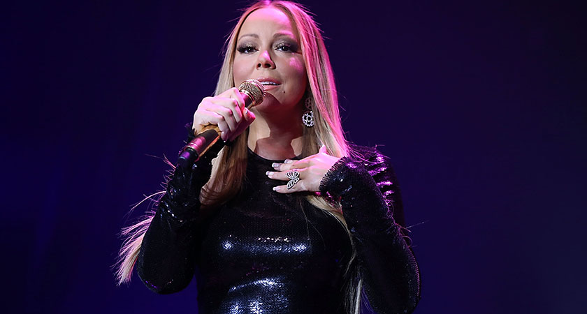 Mariah Carey performs in LA on January 12, 2016 (Photo by Joe Scarnici/Getty Images for Qatar Airways)
