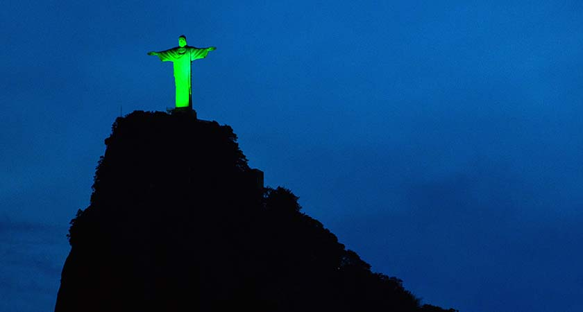 View of the statue of Christ the Redeemer illuminated in green to celebrate the upcoming Irish festivity of Saint Patrick's Day, atop Corcovado hill in Rio de Janeiro, Brazil, on March 15, 2015.   AFP PHOTO / YASUYOSHI CHIBA        (Photo credit should read YASUYOSHI CHIBA/AFP/Getty Images)