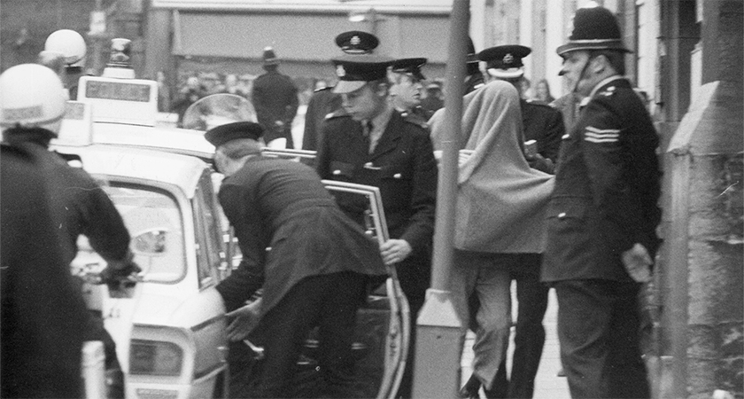 One of the men charged with the murder of Caroline Slater, one of the five people killed when a bomb planted by IRA terrorists exploded in the Horse and Groom public house, Guildford, arriving at court at Guildford. He is covered by a blanket. The accused, found guilty at the trial became known as 'The Guildford Four'. They were released 14 years later, when a court decided that Surrey Police had colluded to mislead the original trial. (Photo by Frank Barratt/Keystone/Getty Images)