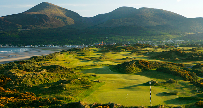 A view looking down The Royal County Down Golf Club, with Newcastle and the Mourne Mountains in the background (Photo by David Cannon/Getty Images)