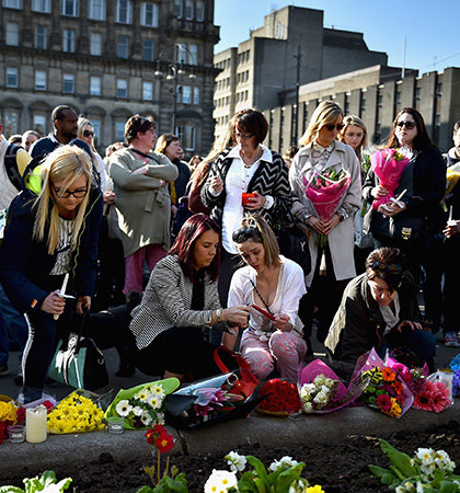 Hundreds of floral tributes were left in Glasgow's George Square in the wake of Karen's death. (Picture: Getty Images)