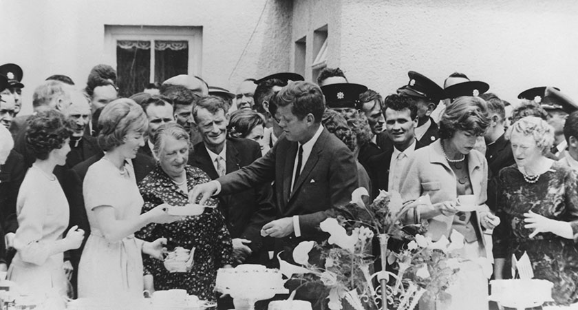 US President John F. Kennedy attends a tea party in his ancestral town of Dunganstown, County Wexford. On the far right is his third cousin Mary Kennedy Ryan. (Photo by Keystone/Hulton Archive/Getty Images)