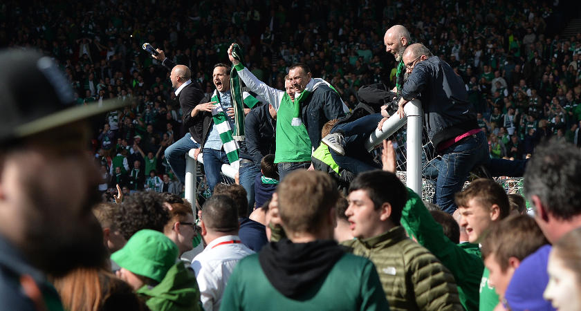 Hibs fans invaded the pitch, prompting a reaction from Rangers' support [Picture: Getty]