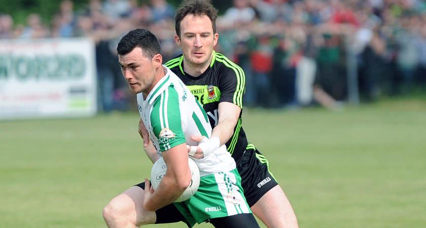 Patrick O'Hara of London escapes Mayo substitute Alan Dillon [Picture: Mal McNally]