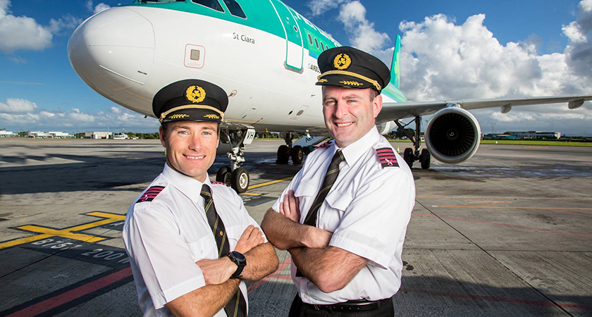 Aer Lingus pilots in front of their plane