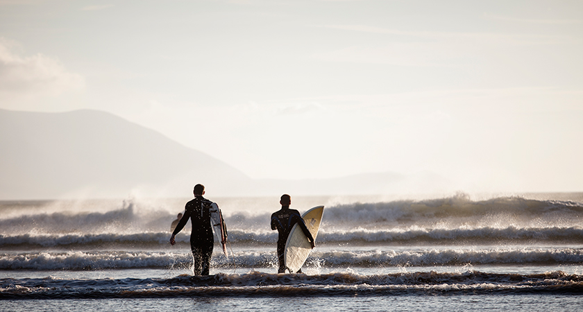 Surfers at Inch Beach.
