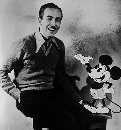 American animator and producer Walt Disney with one of his creations Mickey Mouse. (Photo by General Photographic Agency/Getty Images)