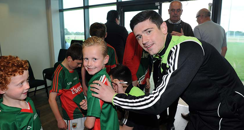 Youngster Joe Kilker with Mayo footballer Conor Loftus at Hazelwood [Picture: Mal McNally]