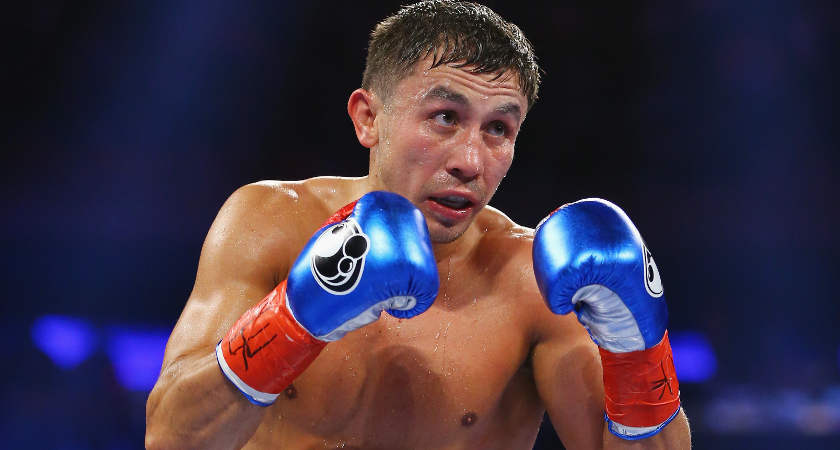 Gennady Golovkin punches David Lemieux during their WBA/WBC interim/IBF middleweight title unification bout at Madison Square Garden on October 17, 2015 in New York City.