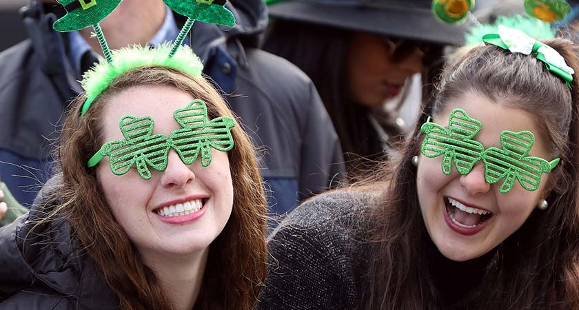 Smiles are seen on the faces of spectators as The St Patrick's day parade makes its way along O'Connell Street, as the largest St Patrick's day celebrations in Ireland makes its way through Dublin city centre on March 17, 2016. / AFP / PAUL FAITH (Photo credit should read PAUL FAITH/AFP/Getty Images)