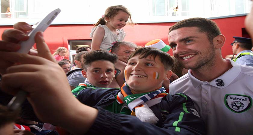 27/6/2016 Irish Fans at Dublin Airport. 14-year-old Dylan Stears from Rathoath, Dublin with Ireland international Robbie Brady at Dublin Airport as the the team arrived home from the European Championships 2016 in France. Photo: RollingNews.ie