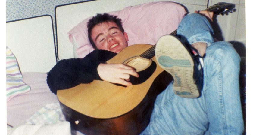 Adrian strumming his beloved guitar [Picture: Damien Devenny]