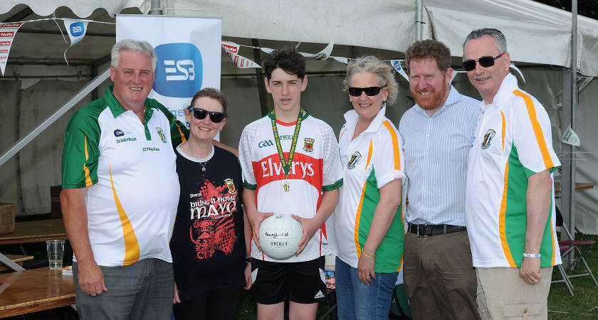 Fearghal pictured with his mother Catherine, 2nd left and LtoR: ABC Chairman John Gormley, Anne Quigley, ABC committee member Michael Kingston and Michael Quigley, General Manager of ESB [Picture: Mal McNally]
