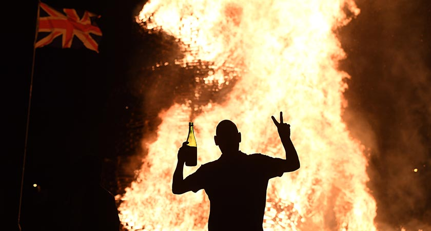 The lighting of the bonfires at midnight on the eleventh night mark the start of the annual twelfth of July celebrations within the protestant community. (Photo by Charles McQuillan/Getty Images)