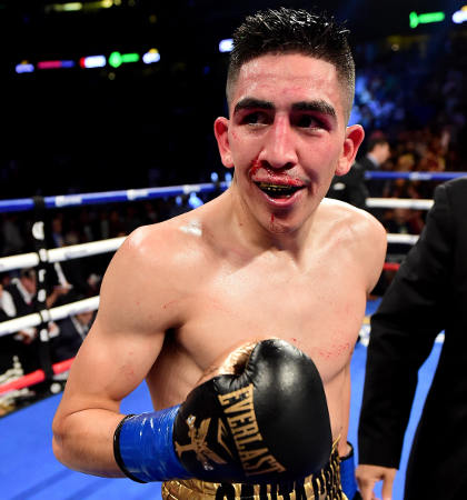 Leo Santa Cruz beats Kiko Martinez in a fifth round TKO to win the WBA Featherweight Super title at Honda Center on February 27, 2016 in Anaheim, California.