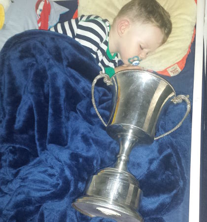 Ronnie Coyne asleep with the All Britain Sam Maguire Cup