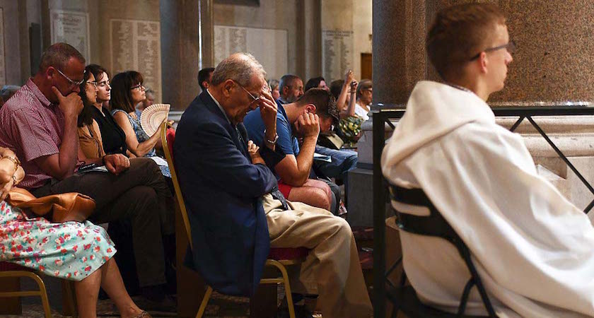 "People attend a Mass at the Sacre Coeur basilica in Marseille in tribute to the priest Jacques Hamel, killed on July 26 in a church of Saint Etienne du Rouvray during a hostage-taking claimed by Islamic State group. France probes an attack on a church in which two men described by the Islamic State group as its ""soldiers"" slit the throat of a priest. An elderly priest had his throat slit in a church in northern France on July 26 after two men stormed the building and took hostages. The attack in the Normandy town of Saint-Etienne-du-Rouvray came as France was still coming to terms with the Bastille Day killings in Nice claimed by the Islamic State group. / AFP / ANNE-CHRISTINE POUJOULAT (Photo credit should read ANNE-CHRISTINE POUJOULAT/AFP/Getty Images)"